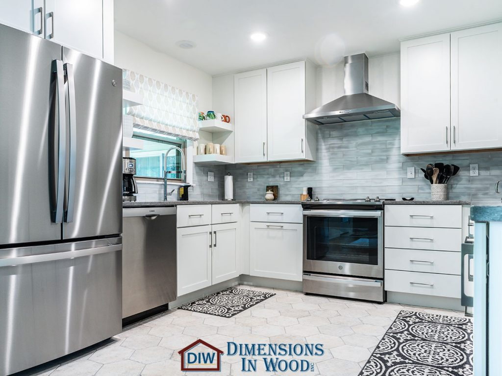 1961 Kitchen and Dining Room Remodeling Tile Floor Crown Molding 60 Years Old Open Concept Bridgewood Cabinets Quartz Countertops Gas Range Stainless Steel Appliances Backsplash Columbia Missouri
